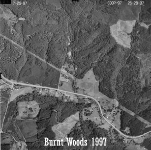 Aerial view of Starker Forests land near Burnt Woods, 1997